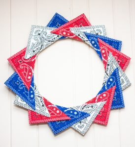 Red, white, and blue wreath made with folded bandanas