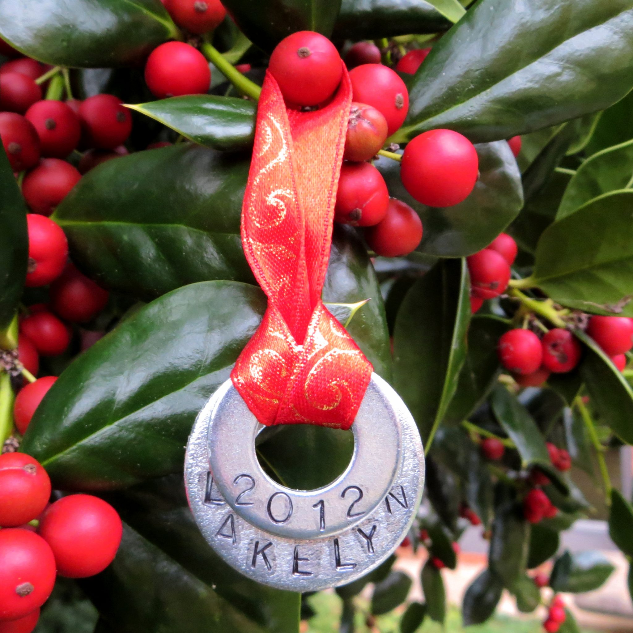 Christmas ornament made with stamped metal washers layered together.