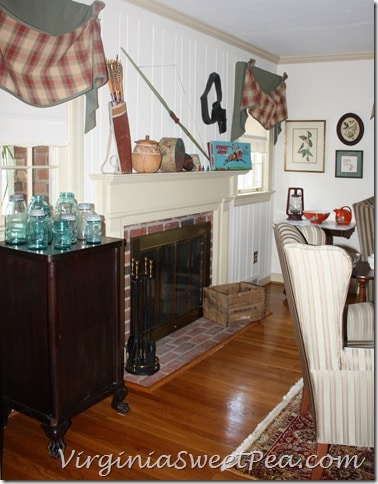 Living Room with Cowboy and Indian Themed Mantel