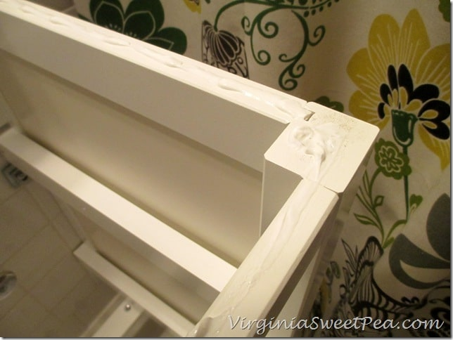 Gluing an Ikea sink to an Ikea cabinet