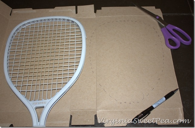 Poinsettia Wreath made using an upcycled Racketball Racket - Get the step-by-step tutorial to make your own Christmas wreath using an old racketball racket.