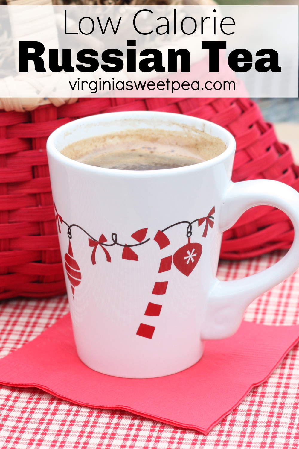 Low calorie Russian Tea in a mug decorated with candy canes and Christmas ornaments