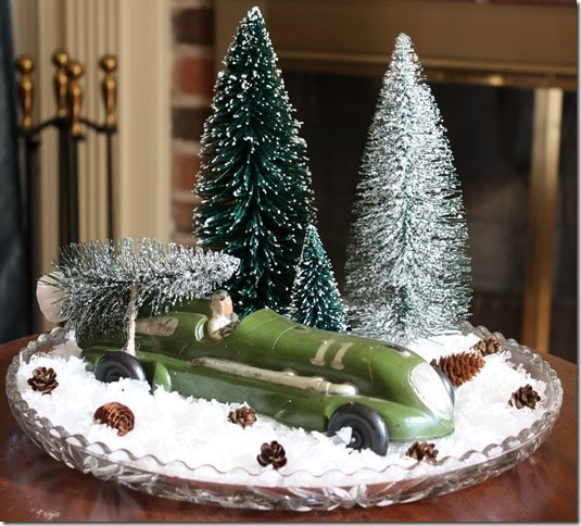 Vintage Toy Car carrying a Christmas tree