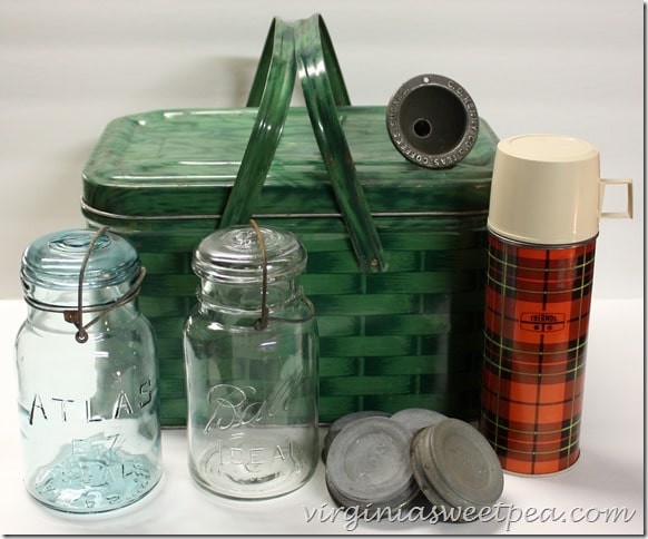 Vintage picnic basket, jars, and thermos. Perfect items for decorating with a vintage flair!