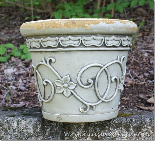 Learn how to revive worn flower pots like this one.  With paint, it can look like new.  virginiasweetpea.com