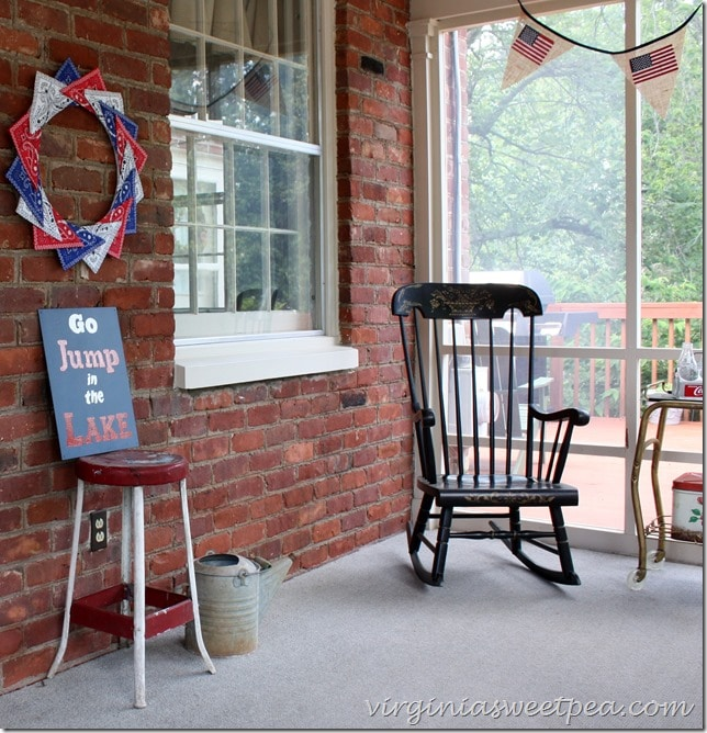 "Patriotic Decor including a bandana wreath, flag banner, and a DIY ""Go Jump in the Lake"" sign. virginiasweetpea.com"