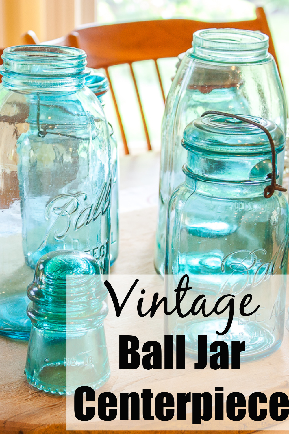 Vintage Ball Jar Centerpiece - Create a beautiful table centerpiece with vintage ball jars and insulators. #vintagecenterpiece #vintageballjars #vintagemasonjars #masonjarideaas via @spaula