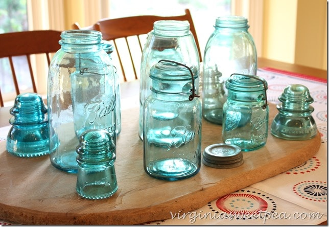 Antique Ball jars used in a patriotic centerpiece.