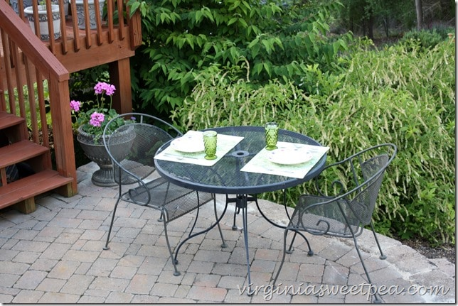 A yard sale patio set makes a nice place to dine.