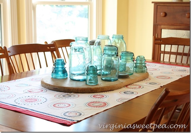 Easy Patriotic Table Runner Made using Flour Sack Towels with a Vintage Mason Jar Centerpiece.