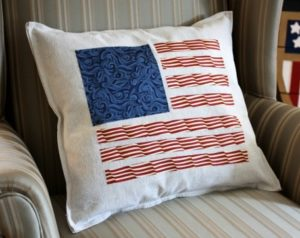 Patriotic pillow made from a drop cloth and quilting fabric. The fabric pieces were cut and ironed on with stitch witchery. This is a quick and easy DIY. virginiasweetpea.com