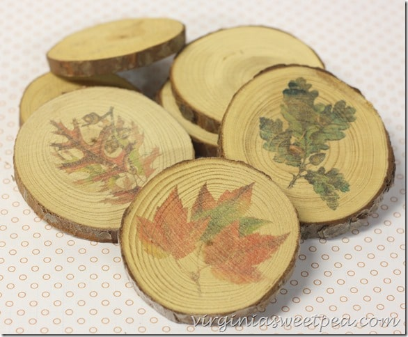 Coasters made from wood slices with fall images.