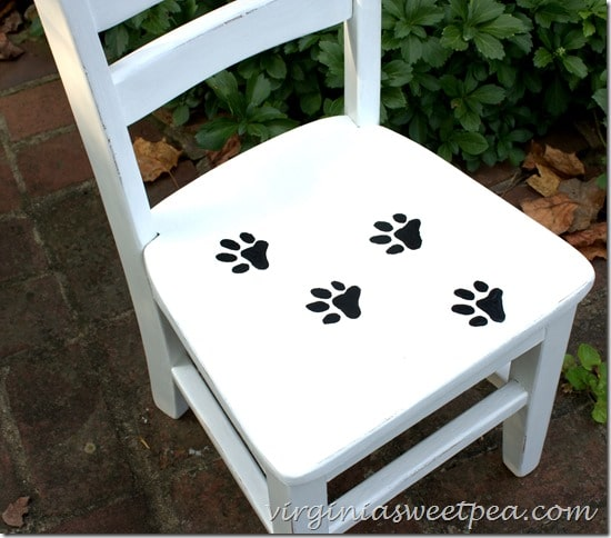 Painted paw prints on this child's chair are so cute! virginiasweetpea.com
