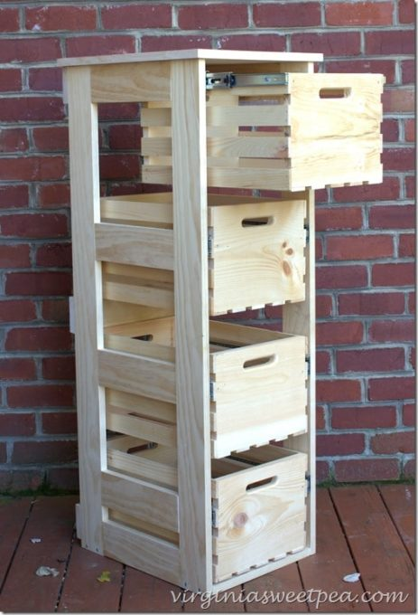 Crates from Home Depot were used to make a filing cabinet style crate cabinet with sliding doors. This can be used for storage anywhere in the home. #diy #diyproject #crate #diyproject