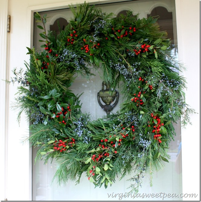 Handmade Christmas Wreath Using Fresh Greenery - Holly and Cedar Berries accent the texture of the greenery used.