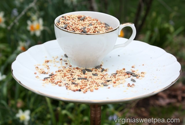 Make a bird feeder using a vintage snack set or a cup and saucer. This easy to follow tutorial shows you step-by-step how to make your own.