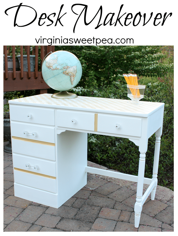 Vintage Ethan Allen desk painted white with gold accents and clear drawer pulls and knobs