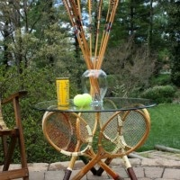 Make a table base using six vintage tennis rackets.