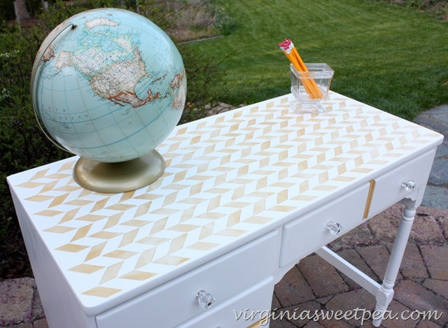 Herringbone stenciled desk top on an Ethan Allen desk made over.