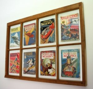 A vintage window is used as a frame for magazine covers
