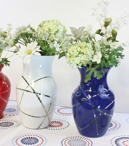 Learn how to make DIY patriotic vases with thrift store vases, rubber band, and spray paint.