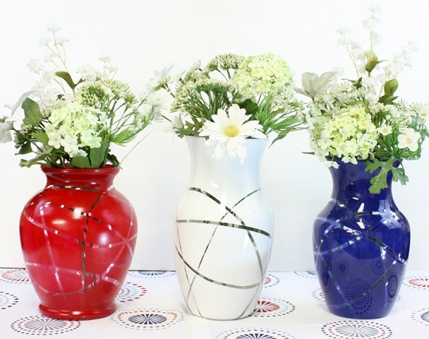 Upcycled Patriotic Vases - Make these using crafts from the thrift store, rubber bands, and spray paint. virginiasweetpea.com