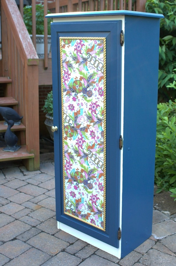 A Sauder cabinet gets a makeover with paint rope trim, and decoupaged gift wrap. Get the details at virginiasweetpea.com