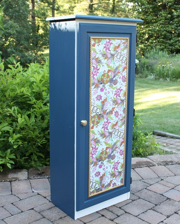A Sauder cabinet gets a makeover with paint and a pretty decoupaged paper door front. Get the details at virginiasweetpea.com.
