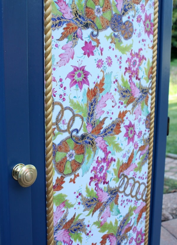 A Sauder cabinet gets a makeover with paint rope trim, and decoupaged gift wrap. Get the details at virginiasweetpea.com.