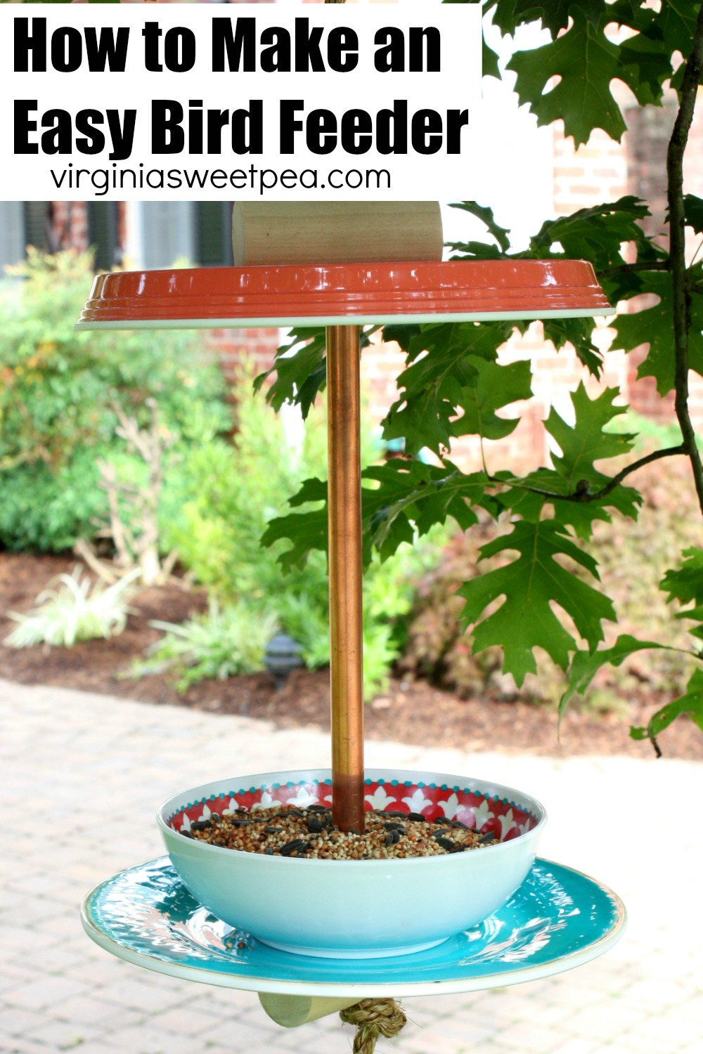 Learn how to make an easy bird feeder with two plastic plates, a plastic bowl, rope, dowel rods, & copper pipe. This is a fun project that birds will love.  #birdfeeder #diybirdfeeder #howtomakeabirdfeeder via @spaula