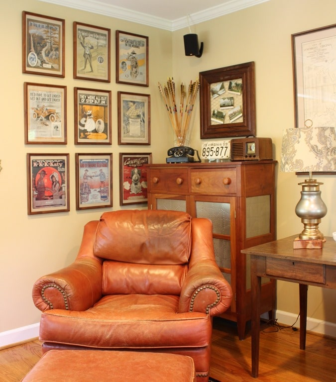 Framed vintage sheet music display with other antiques.