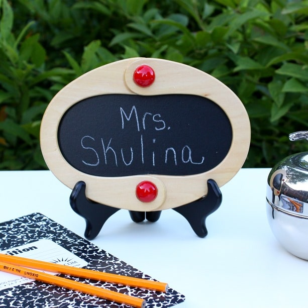 Wooden handles from a thrift shop purse were used to make this framed chalkboard. Get the full tutorial at virginiasweetpea.com.