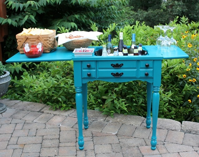 A former sewing cabinet is now an outdoor bar and serving area. This would be so handy to use for entertaining outdoors. virginiasweetpea.com