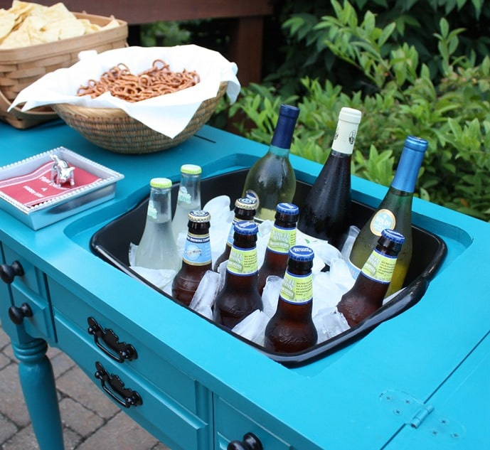 A sewing cabinet is made over into an outdoor bar with an inset sink. Get the full tutorial at virginiasweetpea.com.