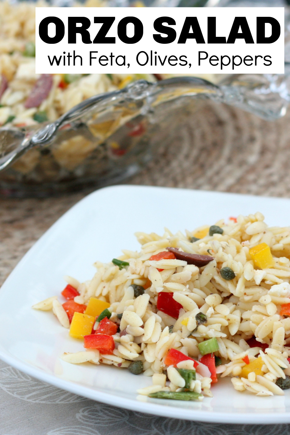 Orzo salad is a perfect side dish for a picnic or dinner party. Tangy feta, olives, and peppers are colorful and add great flavor.  #salad #summersalad #orzosalad #vegetariansalad via @spaula