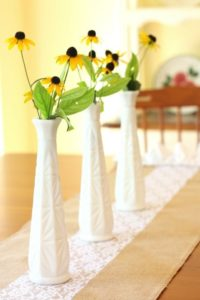 Make an easy burlap and lace table runner embellished with a sweet ruffle. This project can be made in under 30 minutes! virginiasweetpea.com