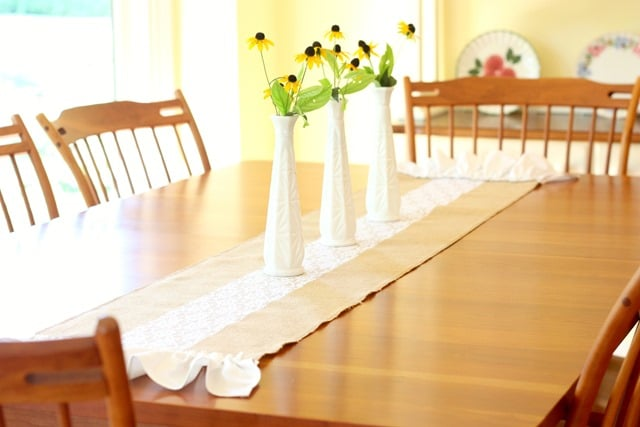 A burlap and lace table runner embelled with a ruffle at either end is an easy 30 minute project that can be enjoyed in any season. Get the tutorial at virginiasweetpea.com.