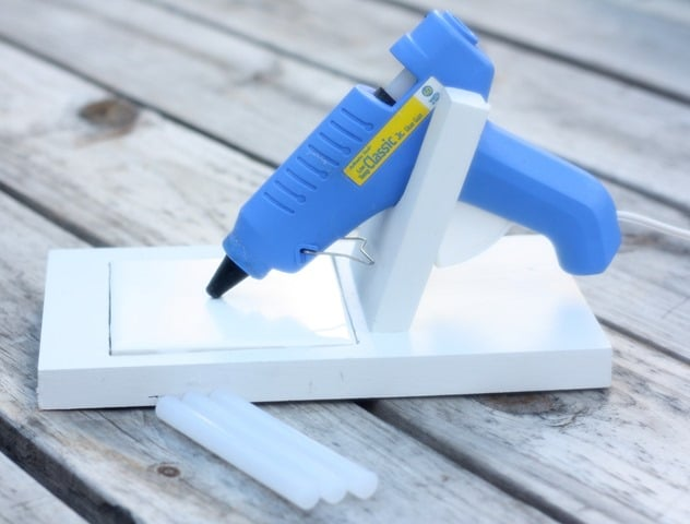 Make a glue gun holder. Get the tutorial at virginiasweetpea.com.