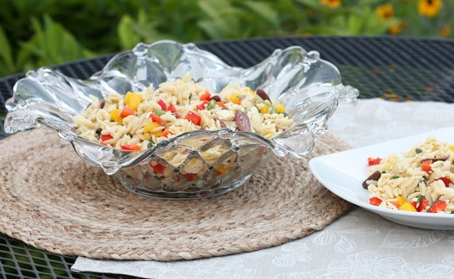 Orzo Salad with Feta, Olives and Peppers is a great side dish. Get the recipe at virginiasweetpea.com.