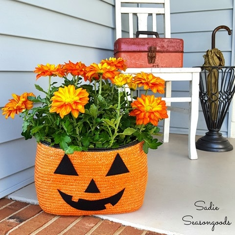 8_orange_black_straw_tote_bag_to_be_repurposed_as_Halloween_pumpkin_jack_o-lantern_porch_planter_for_Pele_mums_by_Sadie_Seasongoods