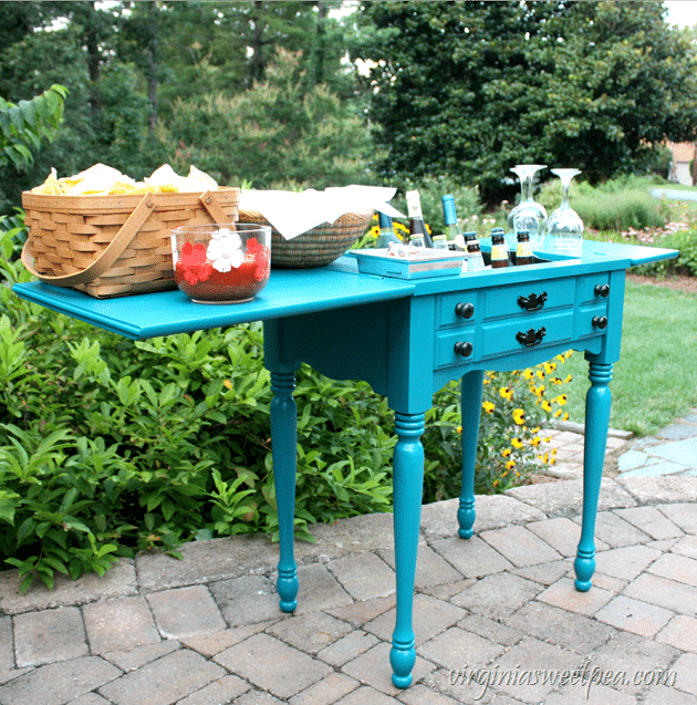 A sewing cabinet found on the side of the road is transformed into an outdoor bar. Get the step-by-step tutorial to make one for your home. #repurpose #upcycle #upcycledproject #repurposeidea #diy #diyproject