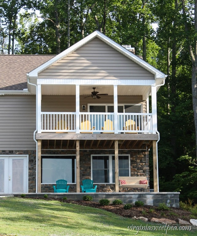 Back of our house at Smith Mountain Lake showing our DIY Adirondack Chairs and our DIY 2x4 Porch Swing