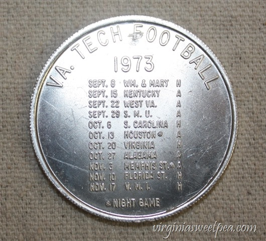 1973 Virginia Tech Student Association Coin advertising the VT Football Schedule - virginiasweetpea.com