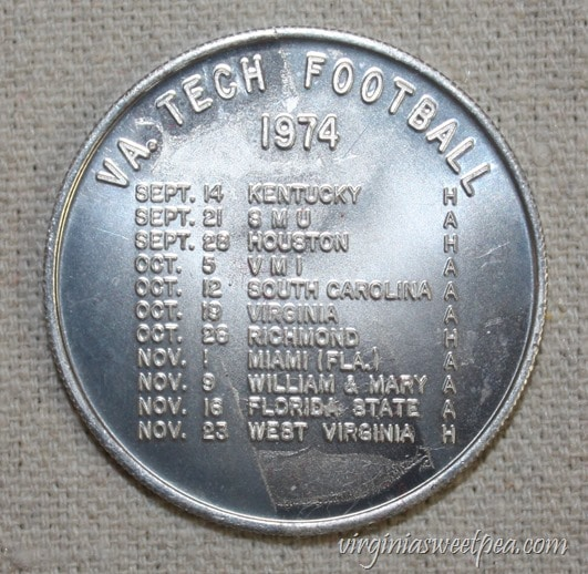 1974 Virginia Tech Student Association Coin advertising the VT Football Schedule - virginiasweetpea.com