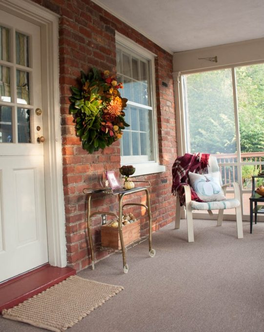 Fall Porch Decor with a Magnolia Wreath Styled for Fall