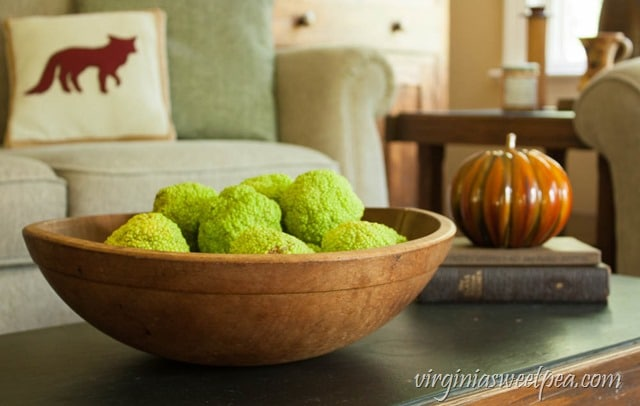 Fall Coffee Table Decor - Osage Oranges in a Vintage Bowl with Vintage Books and a Pumpkin - virginiasweetpea.com