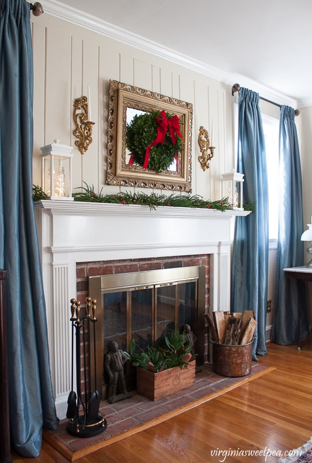 Christmas in the Living Room - Mantel Decorated with DIY Lanterns. Get the step-by step tutorial to make these at virginiasweetpea.com.
