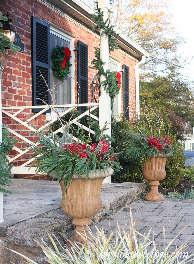 Outdoor Planters Decorated for Christmas - Get the step-by-step tutorial to make these for your home. virginiasweetpea.com
