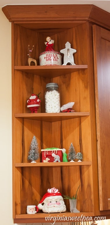 Kitchen Shelves Decorated with Vintage Christmas - See a kitchen decorated for Christmas with vintage finds. virginiasweetpea.com