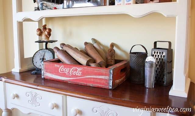 Vintage Coca-Cola crate with an antique scale and small collection of vintage graters. virginiasweetpea.com